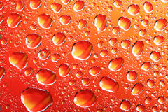 Orange water drops Royalty Free Stock Image