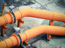 Orange water pipes Stock Photography