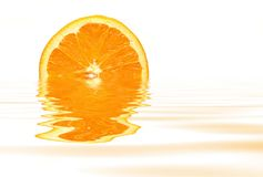 Orange with water reflection. On white background Royalty Free Stock Images