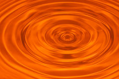 Orange water ripple abstract background Stock Photography