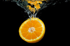 Orange in water Stock Photos