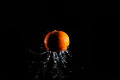 Orange with water splash Royalty Free Stock Photography