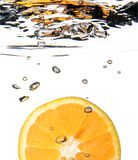 Orange water splash Stock Photos