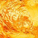 Orange water with splash Stock Image