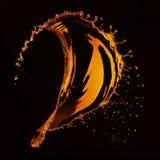 Orange water splash isolated on black Stock Images