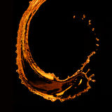 Orange water splash isolated on black Royalty Free Stock Images