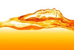 Orange water splash isolated Royalty Free Stock Photos