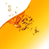Orange water splash isolated on white Royalty Free Stock Image