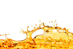 Orange water splash isolated on white Stock Photos