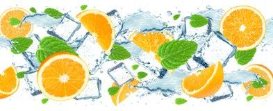 Orange and water splash Stock Photos