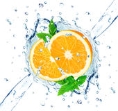 Orange and water splash Stock Images