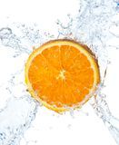 Orange and water splash on a white background Stock Photos