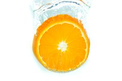 Orange in water splash. On white isolated stock images