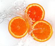 Orange in water on white background Royalty Free Stock Photography