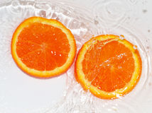Orange in water on white background Stock Photography