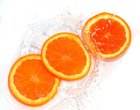 Orange in water on white background Royalty Free Stock Photos