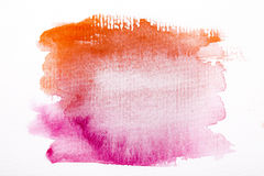 Orange watercolor brush strokes on white rough texture paper  wi Stock Photography
