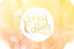 Orange watercolor inscription spring is coming Stock Photos