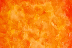Orange watercolor strokes. Handmade orange abstract watercolor background painted on plain paper Royalty Free Stock Photography