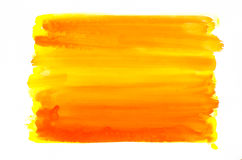 Orange watercolor texture painted on white paper background stock image