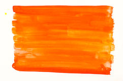 Orange watercolor texture painted on white paper background royalty free stock images