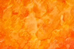 Orange watercolour abstract. Handmade orange abstract watercolour background painted on plain paper royalty free stock images