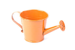 Orange watering can Stock Images
