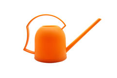 Orange watering can, orange watering pot on white background Royalty Free Stock Images