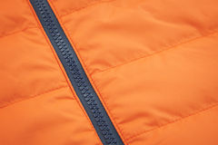 Orange waterproof textile with ziplock background Royalty Free Stock Images