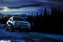 Orange 4wd suv parked in mountain at night Royalty Free Stock Photos