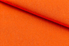 Orange weave material. Texture or background Royalty Free Stock Photos