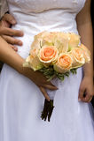 Orange wedding bouquet. The groom and bride holds a wedding bouquet stock photo