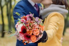 Orange wedding bouquet in hands royalty free stock images