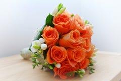 Orange wedding roses. On the table Stock Image