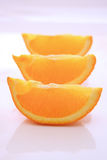 Orange wedges. In a row on a light background Stock Photography
