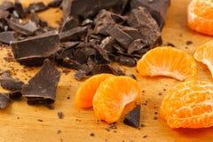 Orange Wedges With Dark Chocolate Stock Photos