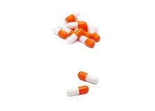 Orange-weiße Pillen Stockbild