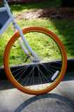 Orange wheel of a bicycle  Royalty Free Stock Photography
