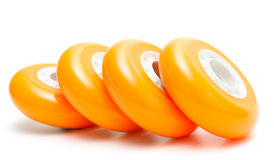 Orange wheels over white Royalty Free Stock Photography