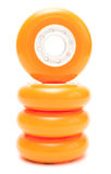 Orange wheels stack isolated over white. Orange inline rollerskates wheels isolated over white Stock Photos