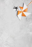Orange whirligig with white stars and black rubber spider Royalty Free Stock Photos