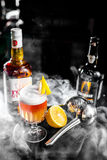 Orange whiskey cocktail with lemon and smoke Royalty Free Stock Photography