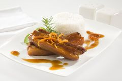 ORANGE AND WHISKEY GLAZED PORK SPARE RIBS Stock Photos