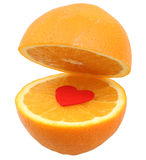 Orange on white. Orange cut in half with red heart in the middle isolated on white with clipping path Royalty Free Stock Photography