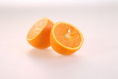 Orange on a white background, halves of a juicy ripe orange on a. White background stock photography