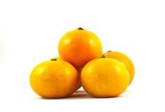 Orange on white background. Several Ripe Orange Mandarins Royalty Free Stock Images