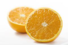 Orange on white background. Two half orange on a white background Royalty Free Stock Photos