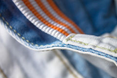 Orange and white belt and jeans Royalty Free Stock Photo
