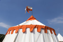Orange and white big top  tent with sky background Stock Photography