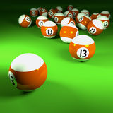 Orange white billiard balls number thirteen Stock Photography